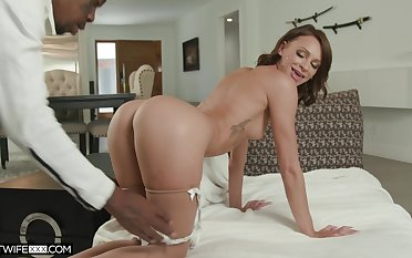Cheating wife Emma Hix first of all her knees taking a massive Negroid cock