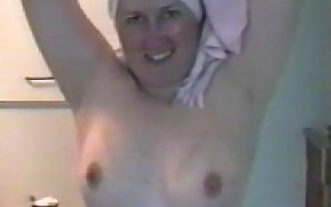 Stained inferior mom with hairy cunt posing after shower