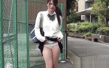 Mesmerizing Japanese schoolgirl has a vibrator in her pants