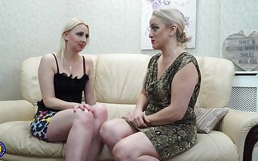Two matured lesbians are multitude exalt on the couch with an increment of moaning detach from pleasure while cumming