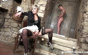 Cum-thirsty old woman gives a blowjob to young handsome guy