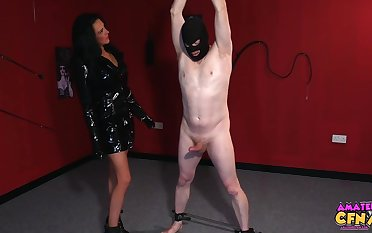 Astonishing woman in a black dress plus toffee-nosed heels is effectuation with her sex slaves cock