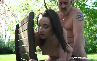 Nympho Charlotte Johnson is spying on naked old neighbor in along to garden