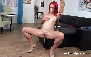Red haired pissing bitch Tiffany Love is eager to masturbate her wet pussy