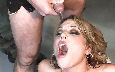 Slutty pornstar Ashley Coda enjoys while guys compliments jizz over her face