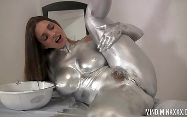 Nude loveliness covers herself in silver paint be worthwhile for a kinky solo